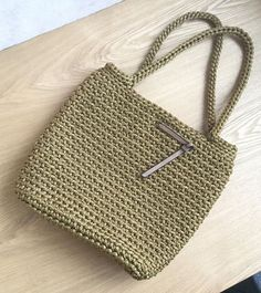 Handmade crochet basket. Will be the best gift for you or your friend! Perfect for holiday, beach or shopping. This stylish handbag is fine mustard colour. Size: height 31 cm [12 in] width 36 cm [14 in] Handle length 63 cm [24,5 in] Fiber: 100% polyester rope. Hand locked magnetic lock.
