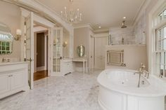 Master Bathroom with Crema Marfil, Marble, Drop-In Bathtub, Radford Cabinets, Inset cabinets, Rain Shower Head, Raised panel