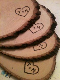 Custom wood burned wedding decorations.