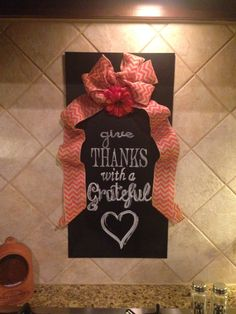 I got this magnetic/chalkboard @ Hobby Lobby & I plan to change the message & ribbon/decor seasonally (sometimes with bible verses & motivational quotes, etc). Ribbon has magnets hot glued to the back & I printed the saying on the computer & transferred it, then painted it on with chalk paint (from grating the chalk & mixing with water). Easy & versatile! Not bad for a quick easy sign! :)