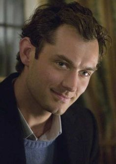 The Holiday--Kate Winslet is brilliant, Eli Wallach kills me, and this look from Jude Law is just perfection. Happy Christmas indeed!