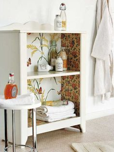 love the idea of using wallpaper to decorate the inside of a simple white shelf!