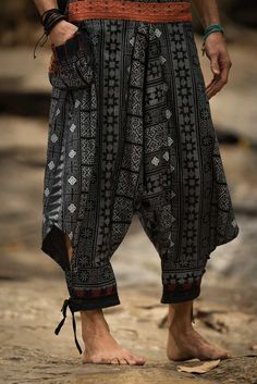 """Amazing Unique High Cut Harem Pants made from fairtrade beautiful traditional hill tribe fabric from the North of Thailand. With open-side legs and ankle cuffs with adjustable straps, you can move freely while practicing yoga, doing the split, or chasing butterflies in the mountains of Pai. Suitable for both men and women. Elastic waist on the back allows the pants to fit most sizes. Measurement: Waist: 26""""to 33"""" Hips: up to 42"""" Crotch: 17"""" Inseam: 20"""" Total length: 35"""""""