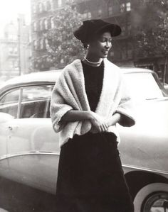 a beauty in Harlem, New York, 1950s fabulous hat and that little jacket with her pearls!
