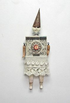Mixed media assemblage by Indiandollartworks on Etsy. Love the monochrome-whiteness of it.