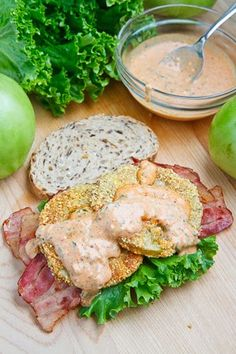 Fried Green Tomato BLT with Remoulade A twist on the classic BLT swapping out the ripe red tomatoes for crispy cornmeal coated fried green tomatoes and adding a tasty remoulade sauce.
