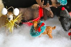 Too Cute.  Give little deer, hedgehogs, buffalo ear muffs and create a wintery scene.