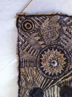 African Mud Cloth/Textile Art on a brown grocery bag. I think this would look great as a larger wall hanging with lots of different panels, hinged together!