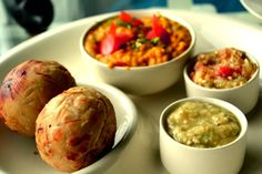 Litti Chokha  A traditional dish of Bihar, served with Channa dal, two types of Aubergine mash, and Whole-wheat balls stuffed with masalas and sattu (roasted gram flour)