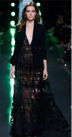 Like the way the jacket and the laced dress combined.Ellie Saab, of course