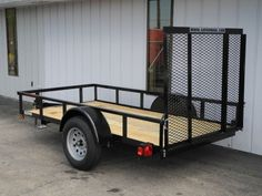 This new 5x10 steel ramp gate utility trailer is a lightweight (780 lb.) trailer suitable for personal or commercial use.  Excellent for hauling cargo up to 2210 lbs.  It features a 5x10 foot treated wood plank cargo bed with a 50-inch steel mesh ramp gate.  It includes a standard hand jack, new 15-inch wheels and tires, tail light angle guards (to protect the tail lamps), powder coated frame, 2-inch coupler system for a 2-inch ball hitch, and is D.O.T. legal in all 50 states.