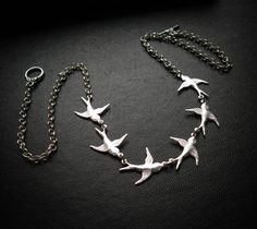 A flight of swallows wings widdershins over your collarbones-- six tiny brass swallows are joined together, hanging from a delicate brass chain. Chose either antique brass, black patina, or bright silver plate finish. I was inspired to make this necklace during the first Christmas rush in the shop, thinking of the mantra from Anne Lamonts book, Bird by Bird. Wear it when you want to be reminded to take it day by day, bird by bird.  This necklace has become popular within the ATS® Belly Dance…