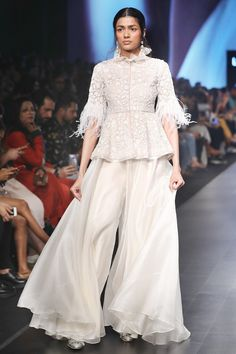 Buy White net peplum blouse & organza sharara pants by Ridhi Mehra at Aza Fashions Indian Gowns Dresses, Indian Fashion Dresses, Indian Designer Outfits, Pakistani Dresses, Designer Dresses, Fashion Outfits, Ethnic Outfits, Ethnic Fashion, Sharara Designs