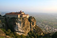 Light of the Fading Day  by ~LesleyanneD One of the mountaintop monasteries of Meteora, Greece, bathed in the light of the fading day.