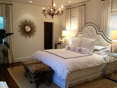 Love everything about this room!! WHITE TUFTED HEADBOARD WITH PIPING LEOPARD X BENCHES