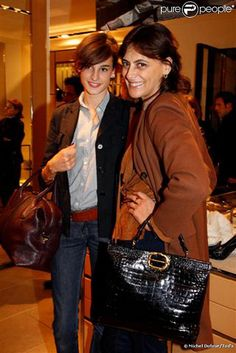 Ines de la Fressange and daughter Nine attend the Cocktail Party at Tods Shops to introduce new book Italian Touch on October 13, 2009 in Paris