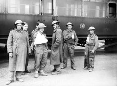 MAY 31 1940 One of the 'little ships' approaches Dunkirk - See more at: http://ww2today.com/ A group of 'walking wounded' British troops evacuated from Dunkirk, in front of a railway carriage at Dover, 31 May 1940.