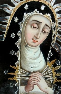 A Spanish painting on glass of Our Lady of Seven Sorrows.