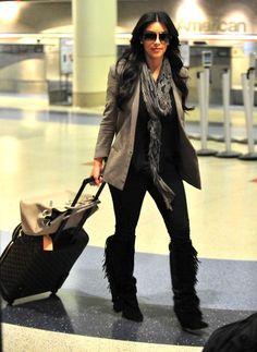Kim Kardashian - Kim And Kourtney Kardashian Arriving On A Flight At LAX