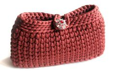 Elegant and stylish ....this handy crochet clutches can be used for casual or formal occasion! 100%HANDMADE It is designed carefully with attention to details and using highest quality italian yarn. Fabulous also the jewel buttons closure in the same shades of the clutch. The color is a RUSTY ORANGE and the dimensions are aprroximately 26 cm for 15 cm This handy clutches,will accompany you as a beautiful complement to your special occasion