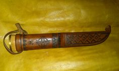 "HISTORICAL Reconstruction of a puukko sheath done for my friend reenacting Finnish Army from Winter War period (his group is actually named ""Suomen Armeija""). The sheath itself is original, I have decorated and finished it."