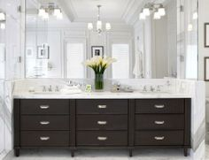 This dark vanity adds contrast to a light and bright bathroom