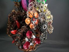 steampunk bouquets   Steampunk bridal bouquet featuring various clockwork parts and rainbow ...