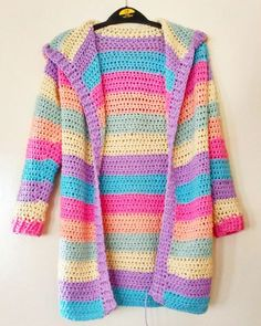 - Relentlessly Purple - Finally, the crochet rainbow unicorn hoody is complete! My second crocheted cardigan so far. They are both pastel rainbow colours Crochet Hoodie, Crochet Coat, Crochet Cardigan Pattern, Crochet Jacket, Crochet Shawl, Crochet Clothes, Crochet Patterns, Crochet Sweaters, Crochet Designs