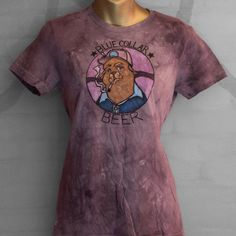 """For a short time between 2009-2010, I used the Birdbrain or """"Corinne"""" labels to create offshoot lines of work. This shirt is one of the cartoon series I created, attempting to get some of my animator kicks in.  Hand-painted and silkscreened with a hand-dyed grey tone. Design features a beaten down union bear. Based on the look on my father's face after work growing up (Local 3 Electrician).  Women's T-shirt, size LARGE."""