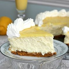 Fantastically creamy, zingy, sweetly delicious looking Triple-Lemon Cheesecake topped with Lemon Curd. #cheesecake #cake #lemon #curd #dessert #food