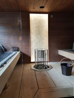 Light wall behind the heater is made from recycled glass. Crushed glass gives smooth light, glistens like diamonds and gives luxurious appeal to the sauna. Crushed Glass, Recycled Glass, Tiles, Recycling, Wall Lights, Bathtub, Luxury, Diamonds, Smooth