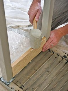 Insert Lumber Between Table Legs With Rubber Mallet
