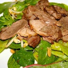 * Salad Daging Kambing * * Bahan: - 1.6 kg paha kambing tanpa tulang (untuk dipanggang) - 240gr daun salad campur - 3 sampai 4 cup tauge - 1 cup roasted peanut (kacang goreng), tumbuk kasar * Bahan Perendam: - 1 cup bawang merah cincang - 6 butir bawang putih, haluskan/cincang - 8 sdm saus ikan - 8 sdm saus asin - 4 sdm minyak sayur - 2 sdm gula merah - 4 sdm perasan jeruk nipis - 3 sdm jahe parut - 2 sdm ketumbar bubuk - 2 sdm saus sambal manis * Untuk saus salad: - 8 sdm saus ikan - 8 sdm…