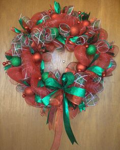 Red and green deco mesh Christmas wreath.
