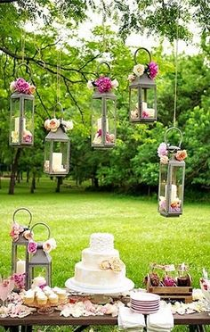 Fabulous outdoor party decor with embellished candle lanterns hanging from tree branches. #diy #eventplanning #dinnerparty #summerparty #partyideas #partydecor #outdoors #gardenparty #wedding