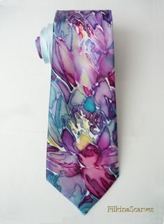 Mens Necktie-Men's SILK Tie-Silk Tie-Blue by FilkinaScarvesFor men who like to be stylish or just looking for an individual accent :) - the latest in men's accessories of FilkinaScarves - Hand Painted Scarves - already in 2017. Unique hand-painted tie with floral elements - water lilies - in blue, purple, gray, petroleum on a light blue background. With use of beewax technique, professionally hand-sewn after being painted. Fabric is 100% natural silk satin, which gives the product more…