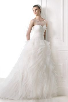 Stunning ruffled ball gown wedding dress with pearl beaded illusion neckline. Pronovias, 2015