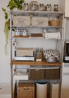 Add solid board to create usable surface on pantry shelf - bar? Also, tidy shelf organization: combo of glass jars, baskets, trays, etc. Kitchen Organization Pantry, Kitchen Shelves, Kitchen Pantry, Diy Kitchen, Kitchen Interior, Kitchen Storage, Home Organization, Kitchen Decor, Wire Kitchen Rack