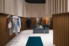Dimorestudio's retail project for French Maison Lanvin [Shanghai] – Trendland Online Magazine Curating the Web since 2006 Cement Walls, Hanging Bar, White Sofas, Retail Interior, Retail Space, Retail Shop, Retail Design, Drapes Curtains, Lanvin