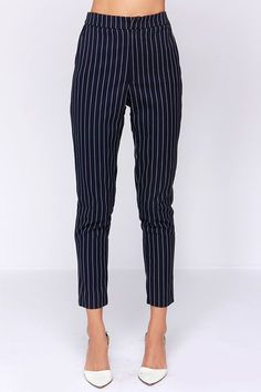 From closing time on a Friday, to 9 am on Monday, the Sunday Girl Navy Blue Striped Pants will make sure you're having the best day of your life! These dark navy blue twill pants have white pin-striping over a fitted high waist and straight-leg cut, making them perfect for work or a casual outing. Two functioning front pockets, and two faux back pockets. Front clasp/zipper closure. Fully lined. Self: 71% Polyester, 27% Rayon, 2% Spandex. Lining: 100% Polyester. Hand Wash Cold.