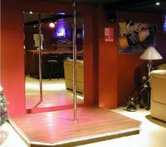"Funny.  Pole mounted on little stage for Man Cave From ""The 15 Best Man Caves on the Internet"""