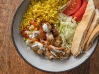 This utterly faithful recipe perfectly recreates a New York City halal-cart classic: Chicken and Rice with White Sauce . The chicken is marinated with herbs, lemon, and spices; the rice golden; the sauce, as white and creamy as ever. Chicken And Rice White Sauce Recipe, White Sauce Recipes, Chicken Rice, Chicken Salad, Pasta Salad, Thing 1, Serious Eats, How To Cook Chicken, The Fresh