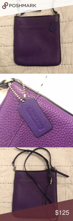 Coach Purse 8.5 x 8 in. Bright purple coach purse. I've had this for many years, it was originally a gift from my grandparents on a shopping trip and i can't find much about it online. It is a smaller crossbody bag with an adjustable strap. Has a smaller pocket on the outside and two small side pockets with a larger pocket on the inside. Small scratch that is barely noticeable (pictured). Coach Bags Crossbody Bags