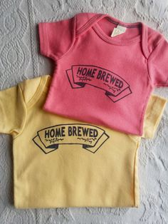 HOME BREWED INFANT ONESIE Colors: Butter Yellow and Pomegranate Pink Limited amount of sizes left of our organic cotton Home brewed Bodysuits  ---  Sizes: Pomegranate Pink 6 - 9 months Butter Yellow 12 -18 Months  Product Info: Hand screen-printed on a Spiritex infant bodysuit 100% Organic cotton  Dimensions: 8 x 12 x 1 inches  - Ultra soft - Machine washable  Product Description: Made in New Orleans, LA -- our Home Brewed onesie is the perfect gift or addition to any infants closet! Made…
