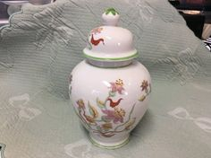 Floral Porcelain Ginger Jar, Japanese Floral Ginger Jar, Asian Ginger Jar, Green Trim, 8 Ginger Jar, Ceramic Ginger Jar, Porcelain Jar  Beautiful Japanese porcelain floral ginger jar. Fresh floral pattern (lilies) with green trim.  Measures 8 tall, 5 1/8 tall without lid, 2 1/2 tall lid, 2 1/4 opening, 2 3/4 base  No damage noted Excellent vintage condition