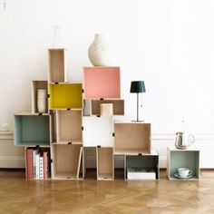Mix and match your shapes and colors for this DIY bookshelf. (via livet hemma)