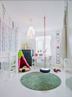 Lord have mercy, I thought that was a pole for a second HAHA. LOVE that round grass rug and an interior tire swing. Great idea! {Not sure what's going on with that neon green and pink teepee, though... :-/ }   www.facebook.com/LFFdesigns