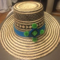 Wayuu Panama hat Brand new Wayuu handwoven straw hat. Hat can be worn with or without the handmade headband.  Here I can include either the blue headband with matching earrings or purple Pom headband. Hat circumference is 55 cm which is a average women's hat size. Made in Venezuela. Each hat takes approximately 8 hours to hand make. Wayuu Accessories Hats