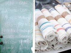 "stamp ""bon appetit"" on kraft paper to wrap around french striped napkins"