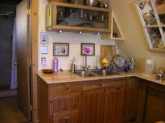 green a frame tiny house kitchen Interior Architecture, Interior Design, Little Houses, Tiny Houses, Glamping, Home Kitchens, Liquor Cabinet, House Ideas, Cabin Ideas